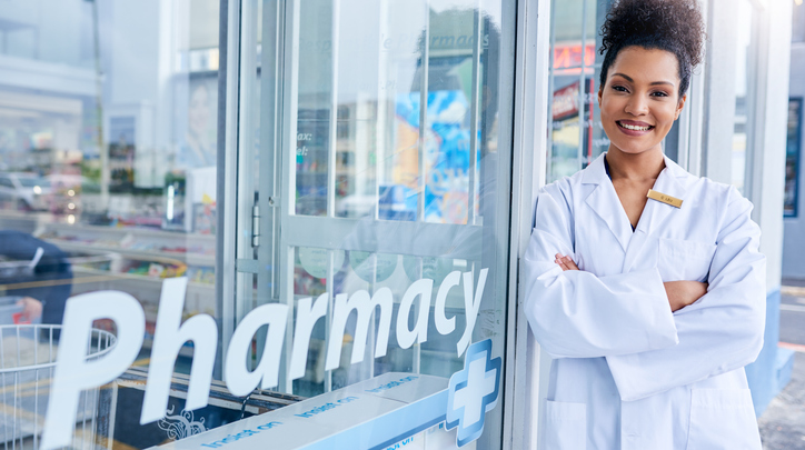 Female Pharmacist Standing in Front of Store