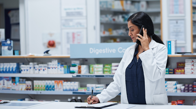 Female Pharmacist Talking on Phone