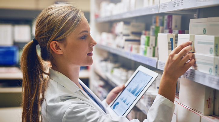 Female Pharmacist with Tablet