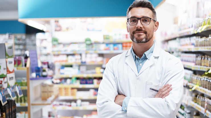 Male Pharmacist Posing in Store