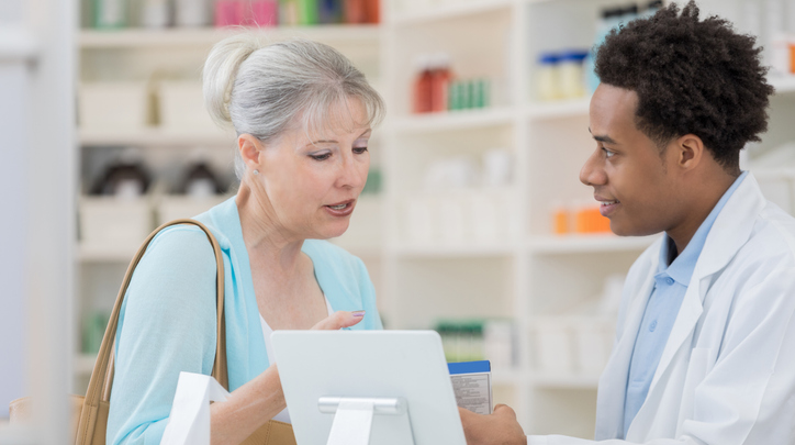 Male Pharmacist with Older Female Patient