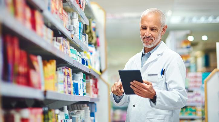 Older Pharmacist Checking Inventory