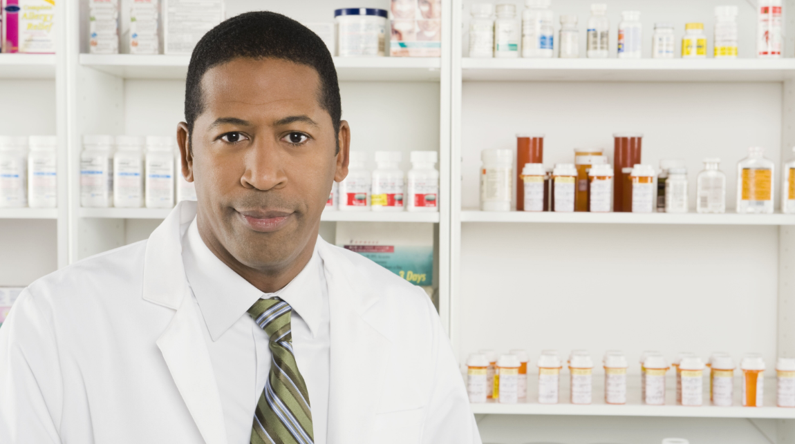 Pharmacist in front of prescriptions
