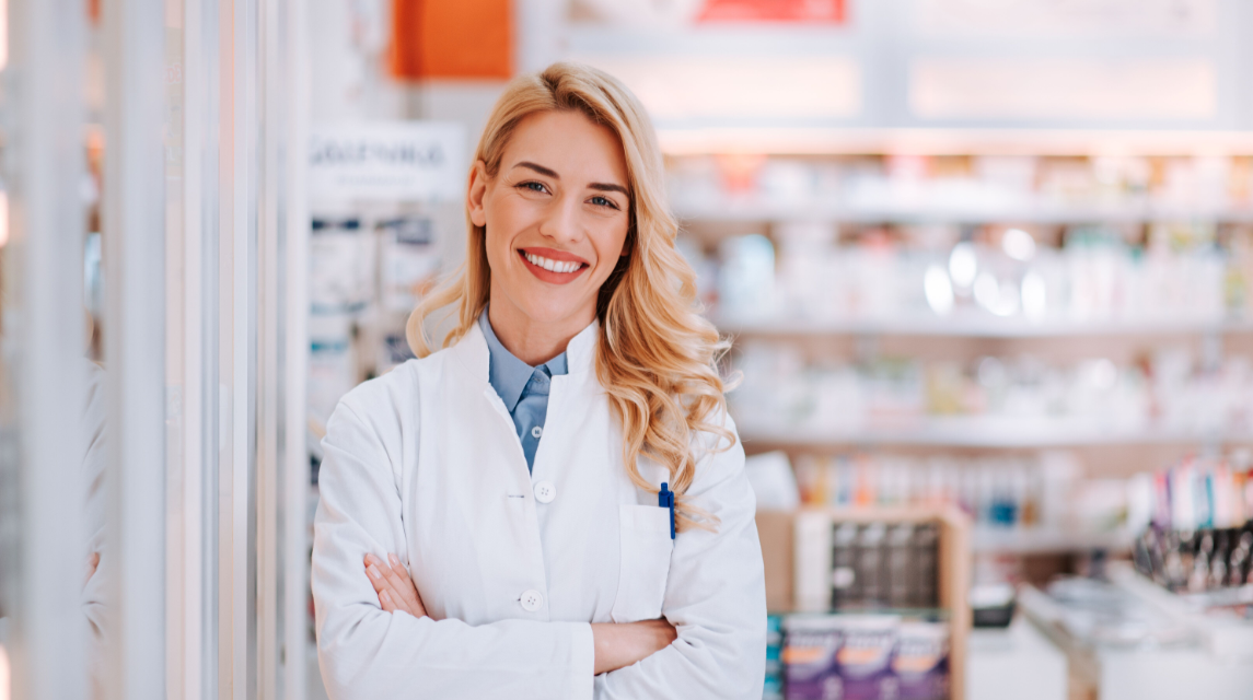 Young Woman Pharmacist  in Front of Pharmacy